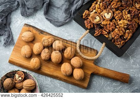 Mature Dried Walnuts In A Wooden Box, Tasty Healthy Walnuts. Top View. Mock Up.