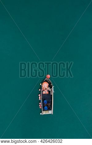 A Traditional Cornish Fishing Boat Floating On A Beautiful Calm Ocean With Copy Space
