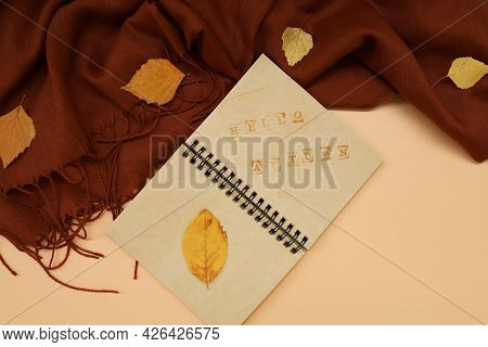 Atmospheric Autumn Composition. Fall Background With Notepad With Hello Autumn Text, Deep Brown Cash