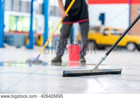 Select The Focus Mop, Service Staff Man Using A Mop To Remove Water In The Uniform Cleaning The Prot