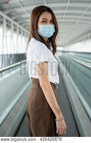Portrait Of A Young Woman In A Medical Mask For Anti-coronavirus Covid-19 Pandemic Infectious Diseas