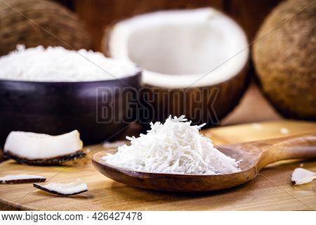 Grated Coconut Wooden Spoon, Coconut-based Ingredient. Food Coconut