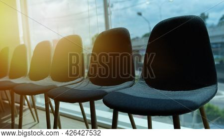 Job Application And Unemployment Concept. Chairs And Sunset Background.