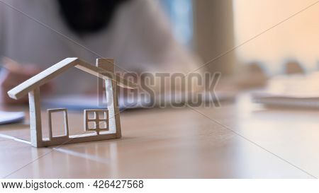 Wood Model House With Real Estate Agents Or Bank Office Working About Home Loan, Sale Housing, House