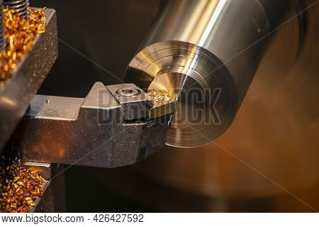 The Close-up Scene Of Lathe Machine Finish Cut Process The Brass Shaft Material. The Metalworking Pr