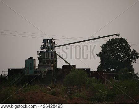 Construction Machine Concrete Mixer Conveyer Belt Equipment Presented Around Forest Background.