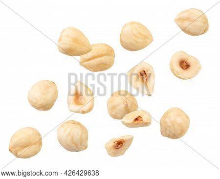 Peeled Hazelnuts Fly Close-up On A White Background, Levitating Hazelnuts. Isolated
