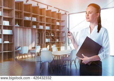 Portrait Of Thoughtful Attractive Businesswoman In Formal Wear Holds Planner And Dreaming About Corp