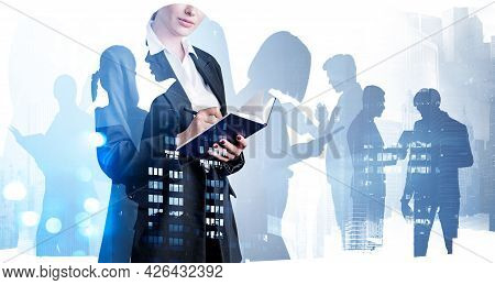 Business Woman Hold Open Notebook And Taking Notes. Diverse Young Professional Business People Worki