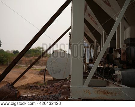 Concrete Mixer Machine Side Cylinder View Around Sky Industrial Background.