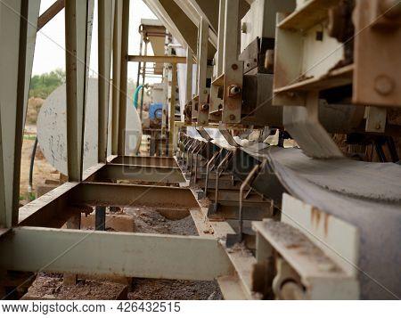 Concrete Mixer Machine Center View At Industrial Background.
