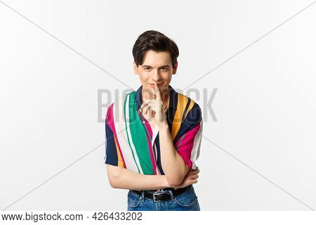 Portrait Of Young Handsome Man Prepare Surprise, Hushing And Smiling, Telling Secret, Standing Over