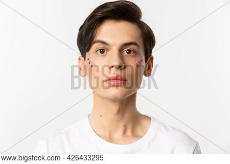 People, Lgbtq And Beauty Concept. Close-up Of Beautiful Androgynous Man With Glitter On Face, Lookin