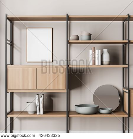 Empty Framed Canvas On The Wall With Bookshelf. Beige Background, Greyish Green And Beige Vases, Mir