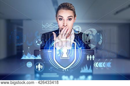 Shocked Businesswoman With And On Mouth Is Looking Into Laptop, Blue Foreground With Hologram Glowin