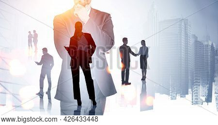 Confident Business Woman Standing With Open Notebook. Silhouettes Of Working Business Partners, Doub