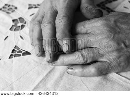 Working Dirty Hands With Mud On Fingers And Nails After Hard Farmer Work. Bw Photo.