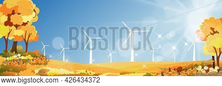 Autumn Landscape Of Windmill Farm At Village With Sunlight Shining In The Morning,turbine Energy For
