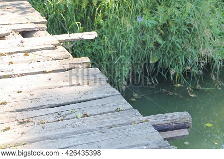 Boardwalk On A Wooden Bridge Over A Quiet River, Sunny Day, July, 2021