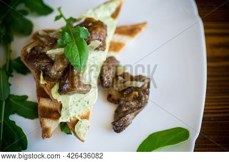 Fried Toast With Cheese Spread, Arugula And Fried Mushrooms