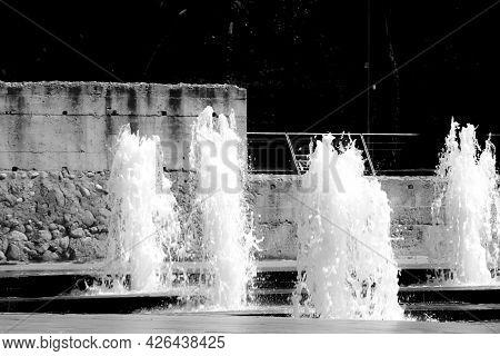 Fountain At Ground Level In The Center Of Elche, Alicante, Spain. Monochrome Picture