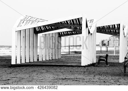 White Wooden Structure On The Beach. Mediterranean Sea In The Background.