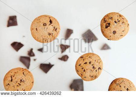 Chocolate Cookies Flying - Chocolate Chip Cookie With Crumbs On Gray Background. Homemade Bakery And