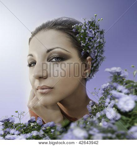 Beautiful Woman With Blue Eyes In Blue Garden