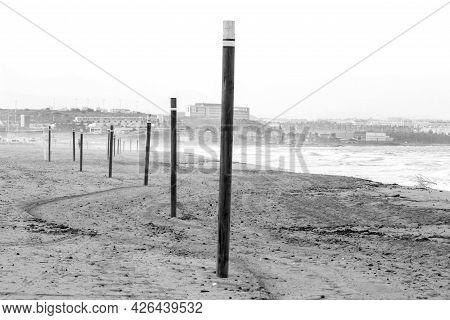 Urbanova Beach And Coast Of Alicante City In The Background. Monochrome Picture.