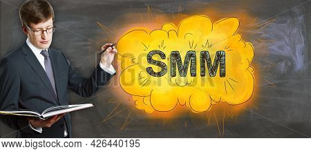 Attractive Businessman With Open Book And Creative Bright Smm Cloud Sketch On Concrete Wall Backgrou
