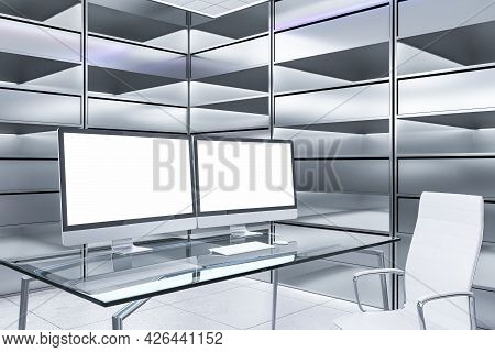 Abstract Futuristic Office Interior With Two Blank White Computer Screens On Desk And Silver Bookcas
