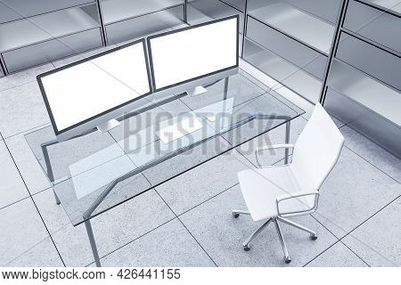 Abstract Futuristic Office Interior With Two Blank White Computer Displays On Desk And Silver Bookca