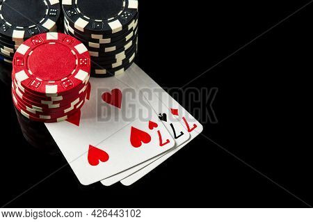 Poker Game With Three Of A Kind Or Set Combination. Chips And Cards On The Black Table In Poker Club