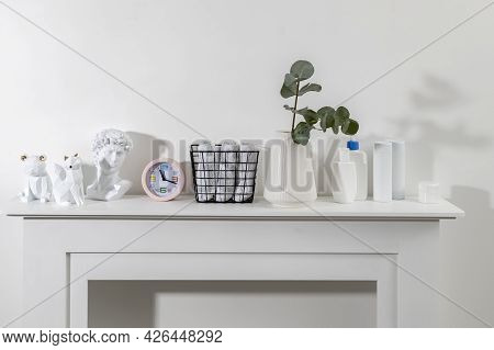 Figurines Of A Bear, Fox Are On The Surface Of The Chest Of Drawers. A Vase With A Eucalyptus Branch