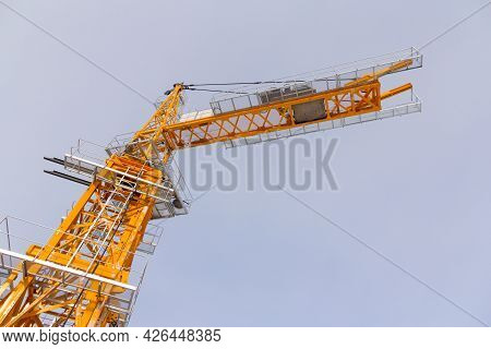 Tower Crane Assembly. Installation Of A Construction Crane Before Starting Construction. Constructio