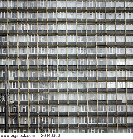 A Fragment Of The Glass And Sandstone Facade Of Modern Office Building. Wide Abstract Fragment Of Mo