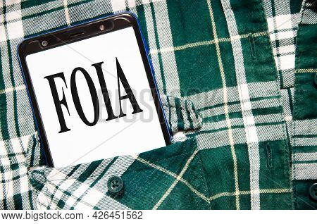 Foia Concept Word Written On The White Screen Of The Phone That Lies In The Shirt