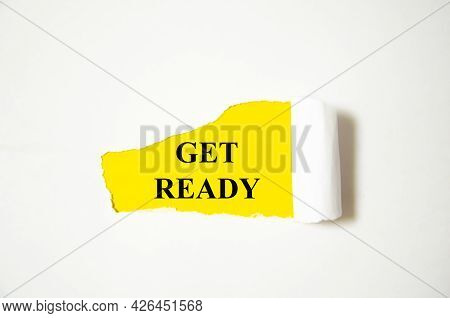 Get Ready The Text Is Written On A White Background And A Yellow Piece Of Paper
