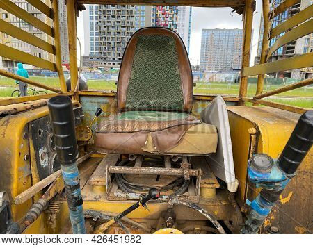 Panorama Frame Seat And Control Sticks Inside The Open Cab Of A Heavy Duty Machinery
