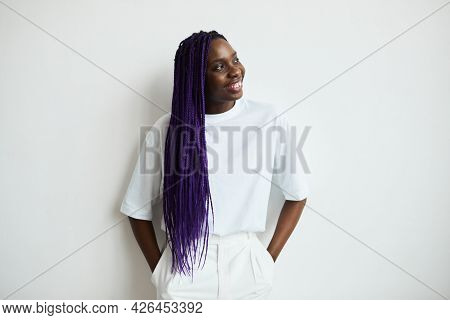 Minimal Waist Up Portrait Of Carefree African-american Woman With Colored Hair Standing Against Whit