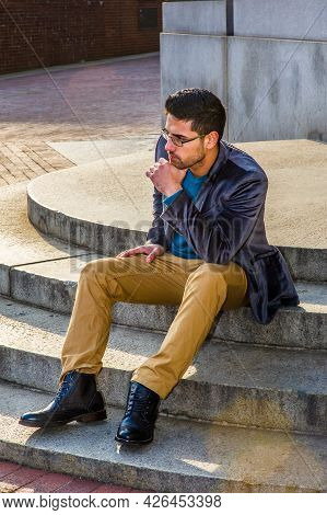 Dressing In A Dark Purple Woolen Blazer,  Dark Yellow Pants And Leather Boot Shoes, Wearing Glasses,