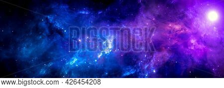 Blue Purple Cosmic Background With A Bright Nebula And A Cluster Of Stars