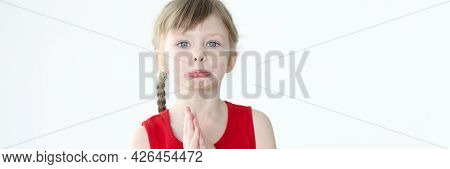 Portrait Of An Offended Little Girl With Blond Hair