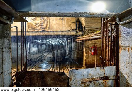 The View From The Mine Elevator, The Mine Tunnel Is Visible, A Stream Of Outlet Pours From Above.