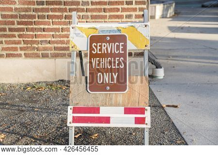 Service Vehicle Only Signage On A Foldable Poster Stand