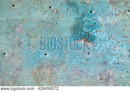 The Texture Of The Old Iron Sheet. Cracked Paint On The Iron. Grunge Texture On An Iron Sheet Of Met