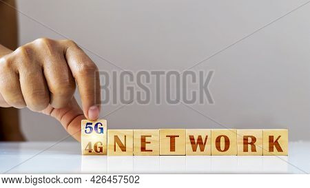 Hands Are Turning The Cube Of 4g Numbers To 5g, The Concept Of 5g Network And The Connection Of Futu