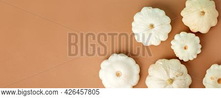 Autumn Frame Made Of White Pumpkins Squash On Beige Brown Table Background. Fall, Halloween, Thanksg