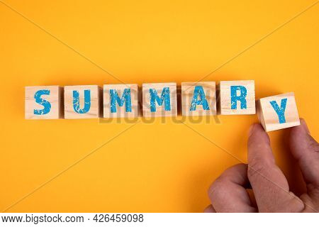 Summary Concept. Wooden Blocks With Letters On A Yellow Background