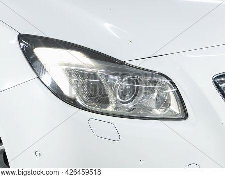Novosibirsk, Russia - June 29, 2021: Opel Insignia,  Close Up Of The Car Headlights. Exterior Closeu